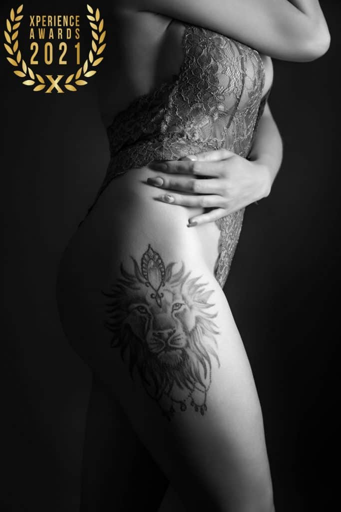side on boudoir image with tattoo